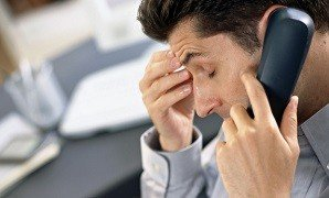 Male stressed in office